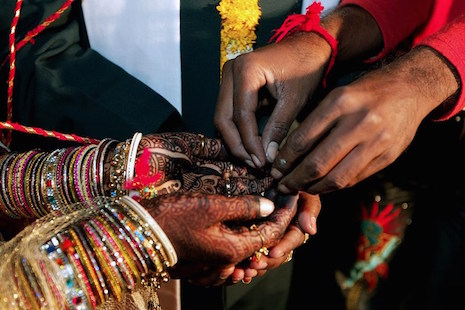 Rituals are performed during a traditional Hindu marriage ceremony at an all community mass marriage at Viramgam, some 60 km south of Ahmedabad, late on May 9, 2008. A total of 888 couples (700 Hindus and 188 Muslim couples) tied their knots at the event orgainsed by the